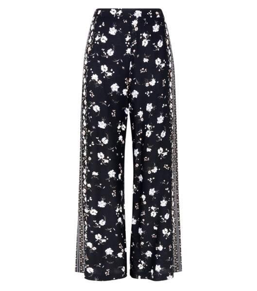 Pantalon large noir à imprimé floral sur le bord, New Look, 24,99 euros