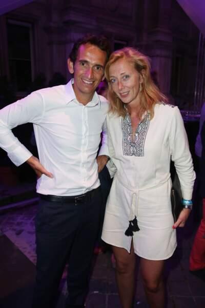 Le président de la Fnac Alexandre Bompard et sa femme