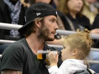 DIAPO David Beckham n'a d'yeux que pour sa petite Harper