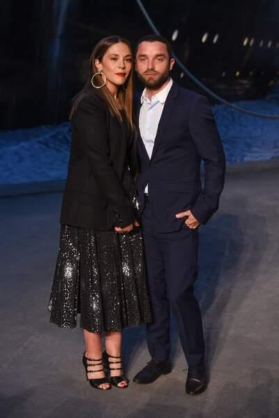 Alysson Paradis et Guillaume Gouix au défilé Chanel croisière 2018, le 3 mai au Grand Palais