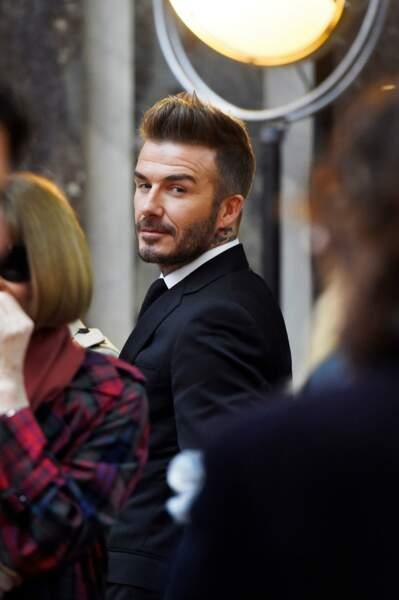 David Beckham qui regarde sa femme à la fashion week de New York, le 11 février 2018