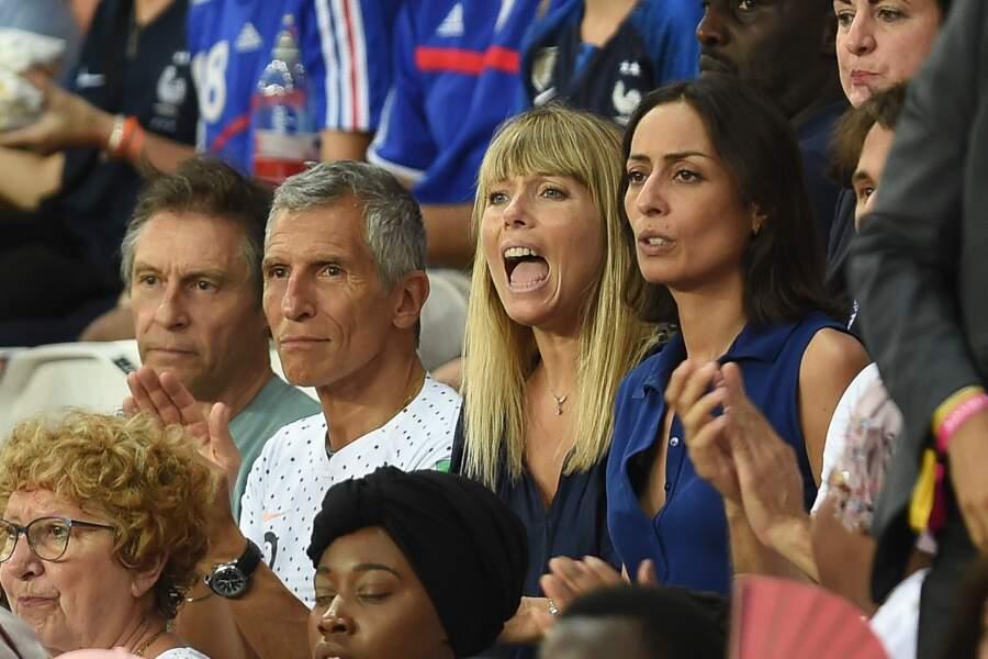 Nagui, sa femme Mélanie Page et la journaliste Leïla Kaddour-Boudadi lors du match de l'équipe de France le 28 juin