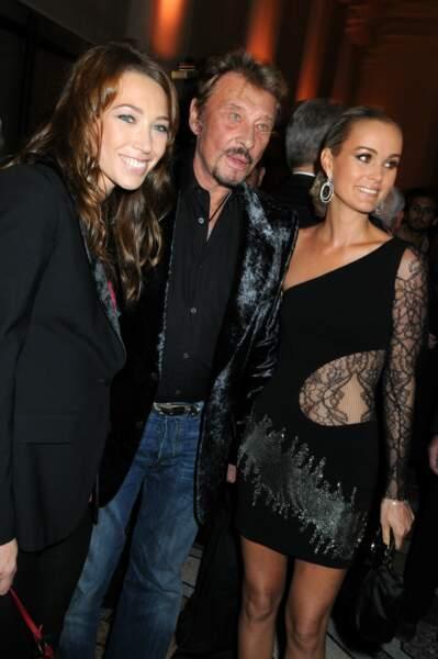 2008 : Johnny Hallyday entouré de Laura Smet, sa fille, et Laeticia Hallyday, sa femme