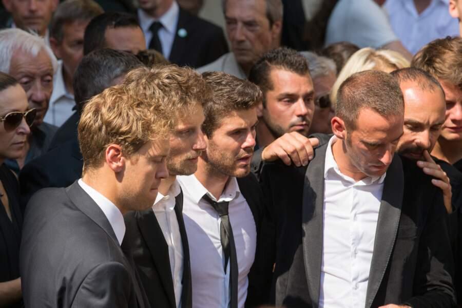 Les pilotes Sebastian Vettel et Romain Grosjean