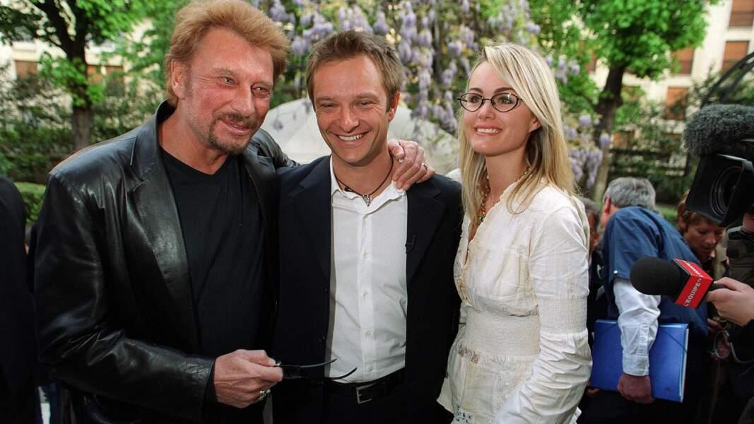 Avec son père Johnny et sa belle-mère Laeticia
