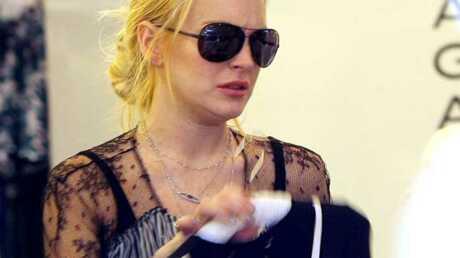 PHOTOS Lindsay Lohan fait son shopping au Printemps à Paris