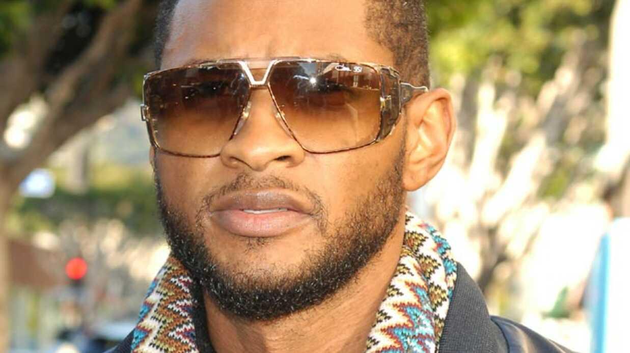 VIDEO Usher frappé par une fan en plein concert