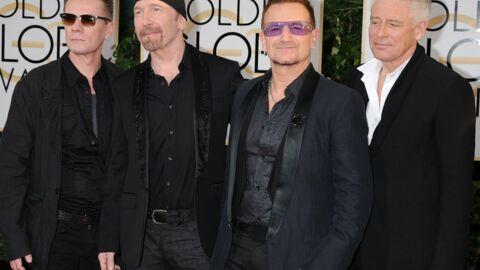 Attentats de Paris: Bono et les musiciens de U2 se recueillent devant le Bataclan