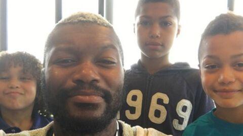 PHOTO Djibril Cissé: moment de complicité sur le terrain de foot avec ses trois fils