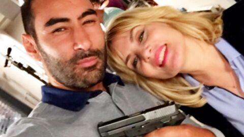 PHOTO La Fouine pose avec une arme aux côtés d'Emmanuelle Seigner