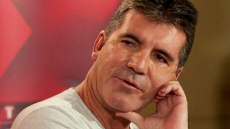 Simon Cowell (X Factor) attend un enfant avec la femme d'un de ses meilleurs amis