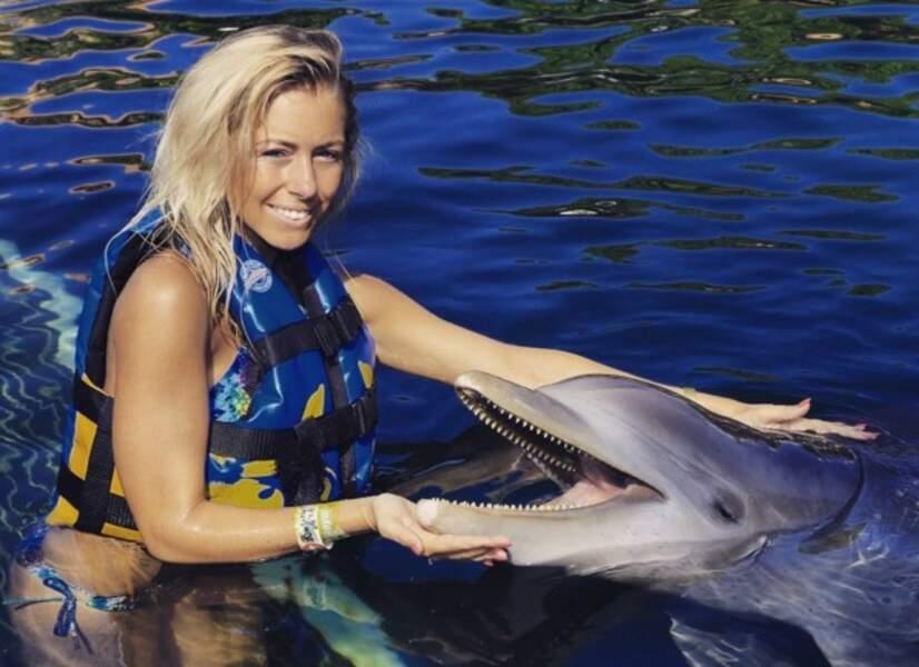 ...et câlin à des dauphins