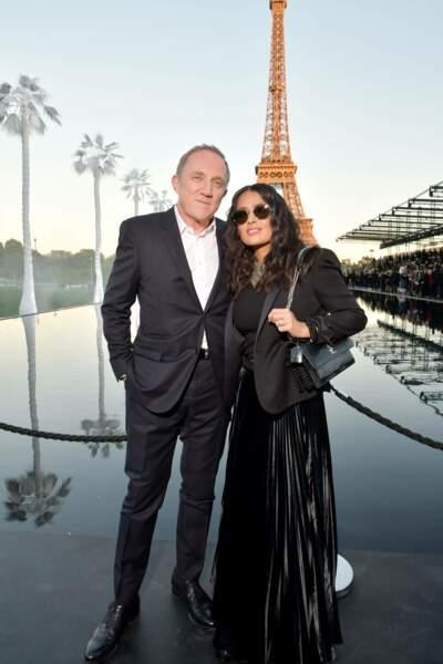 Salma Heyek et François-Henri Pinault au défilé Saint Laurent à la fashion week de Paris, le 25 septembre