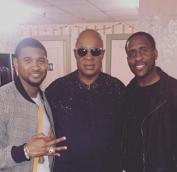À droite, à côté d'Usher et de Stevie Wonder, Ryan Toby a bien grandi