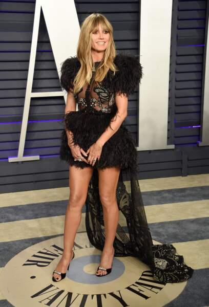 Do Heidi Klum dans une robe sexy et glamour