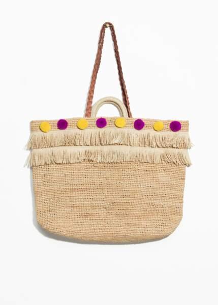 &Other Stories, sac en paille avec pompons de couleur et franges, 59 €
