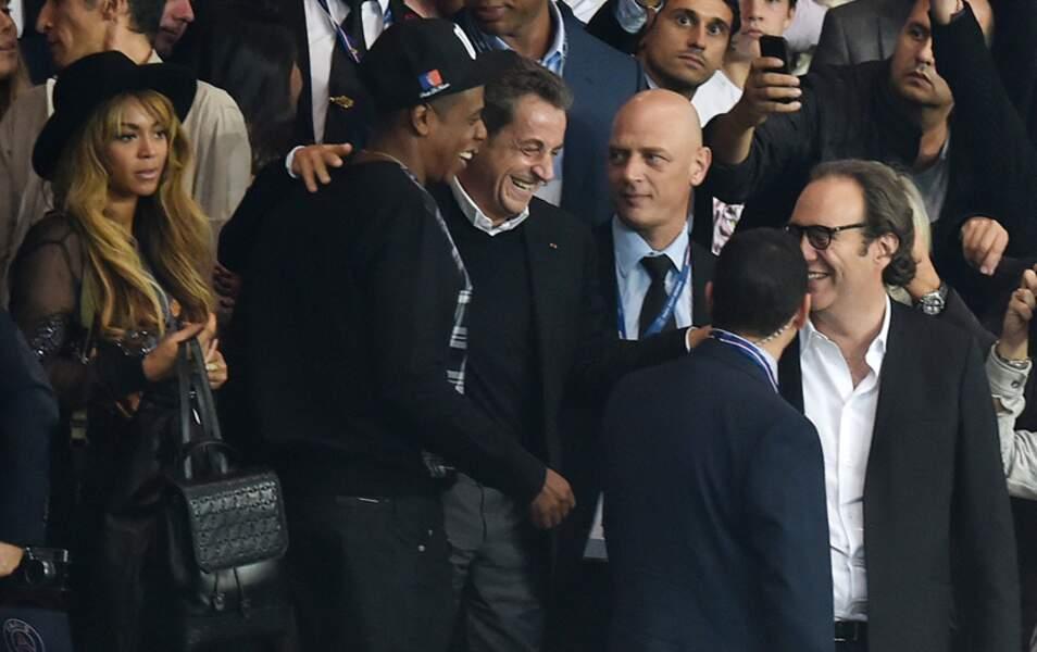 Nicolas Sarkozy, Jay Z et Xavier Niel, le patron de l'opérateur Free